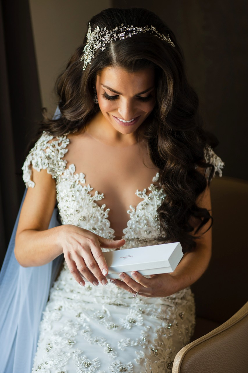 Bride opening a wedding gift at Logan Hotel in Philly