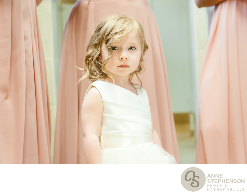 Flower Girl with Bridesmaids in Pink as Background