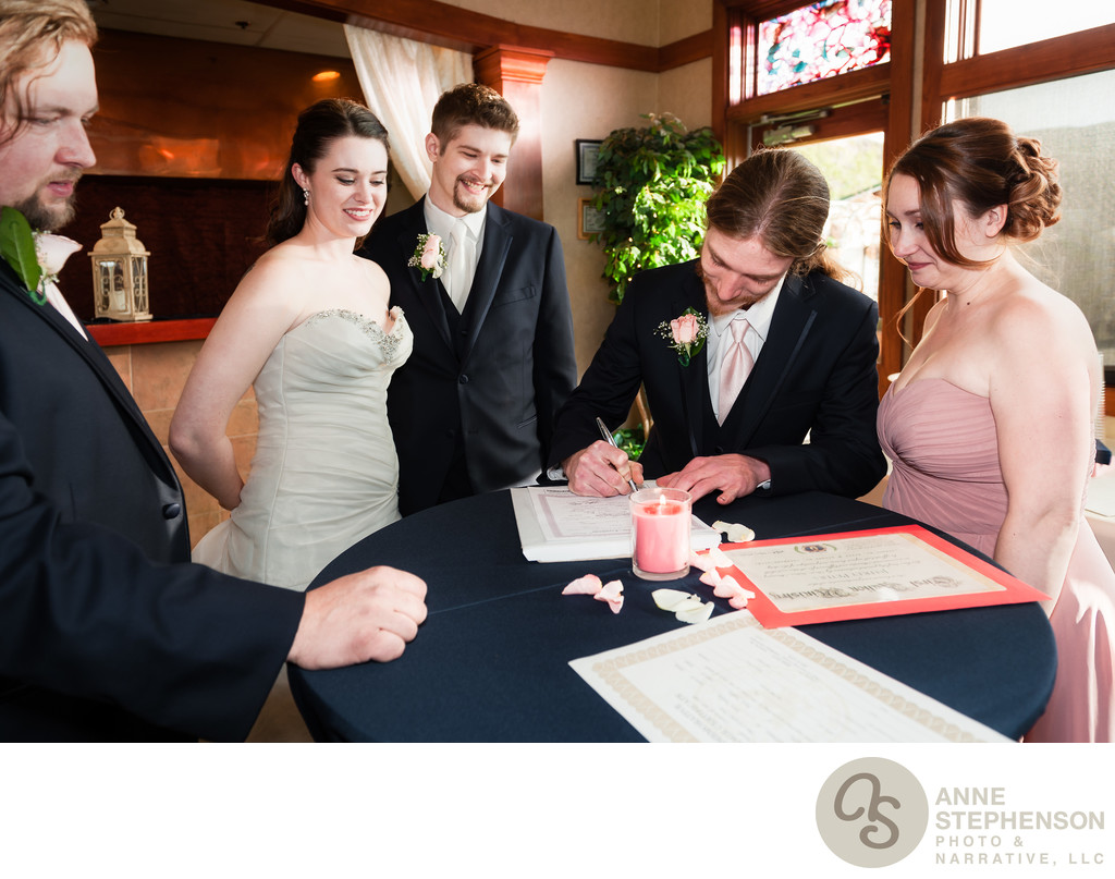 Witnesses Sign Marriage License for Wedding Couple