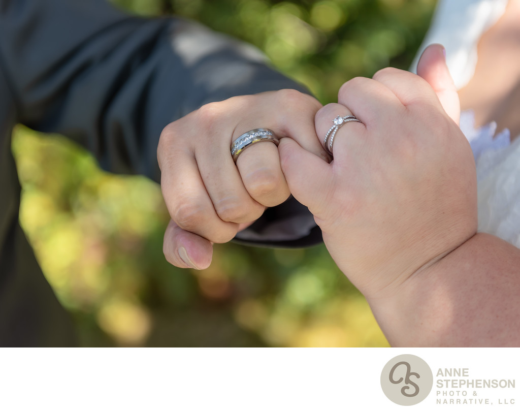 Bride and Groom Show Rings During Pinkie Swear