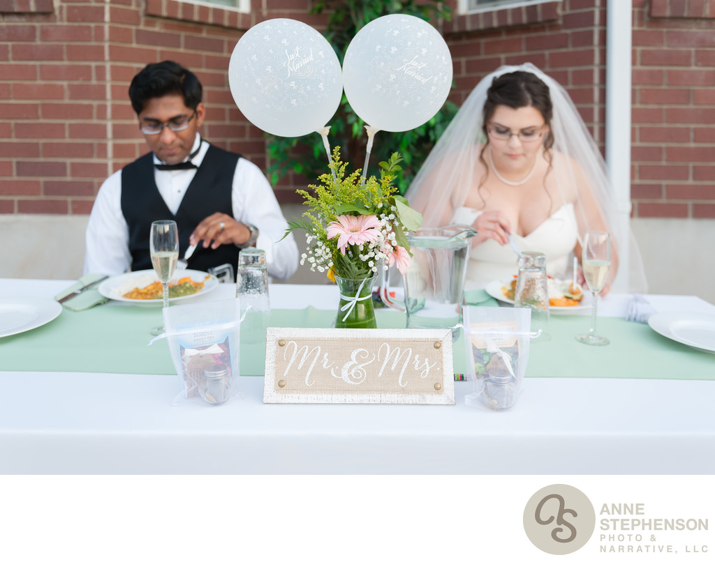 Bride and groom enjoy their meal