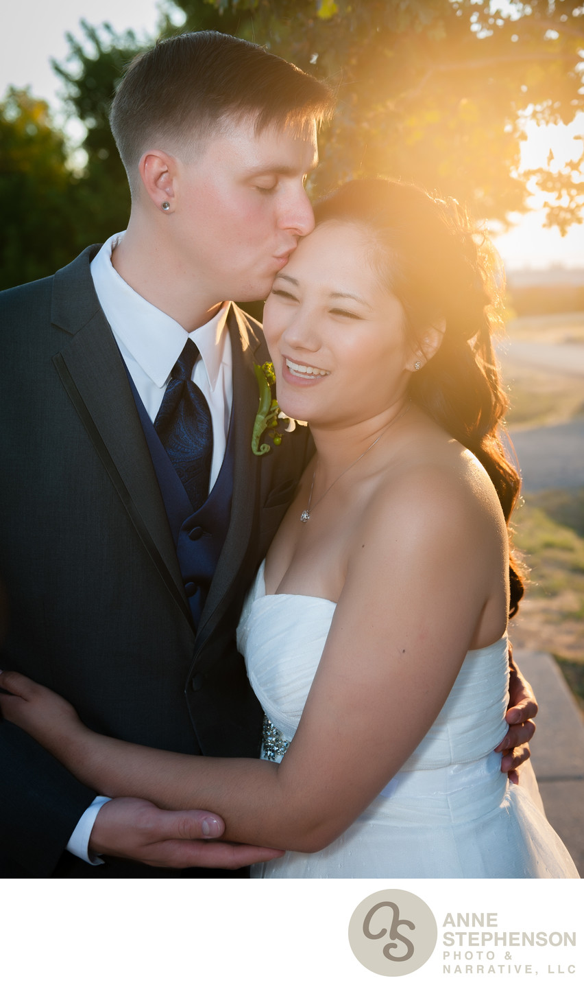 Backlit Wedding Couple Portrait with Sun Flare