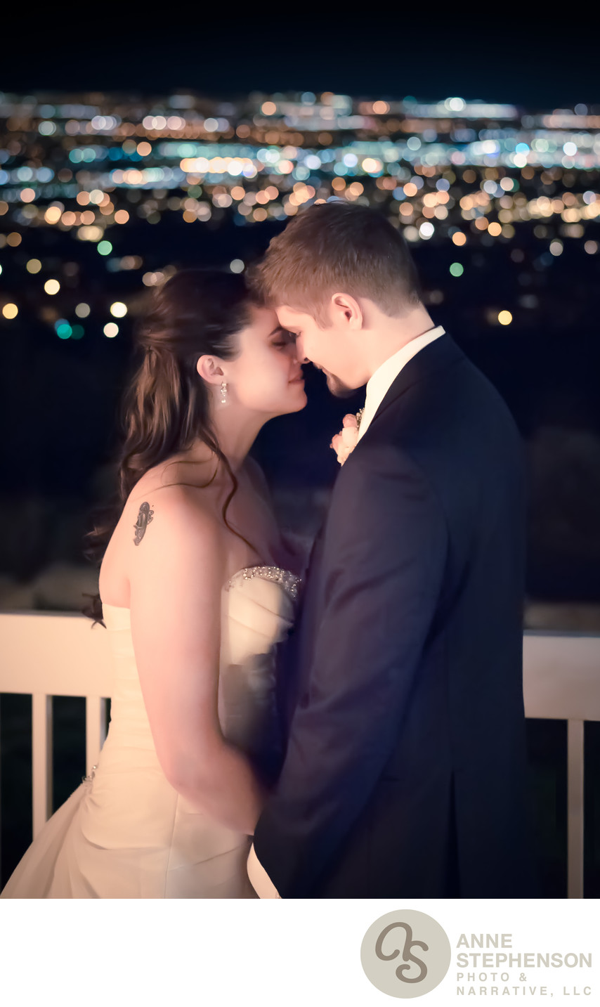 Evening Portrait of Bride and Groom with City Lights