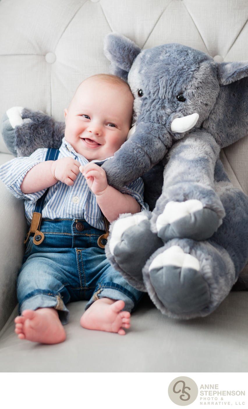 Baby in Favorite Chair with Stuffed Elephant