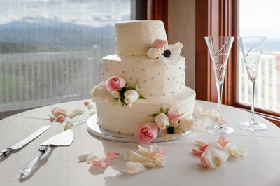 Wedding Cake with Pink Roses and Champagne Flutes