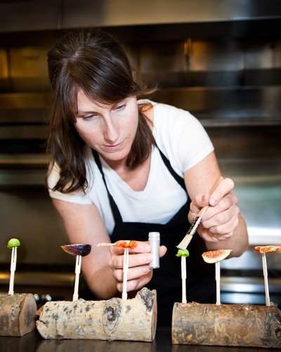 Chef Katie Weinner dusts her final creations with the finishing touch