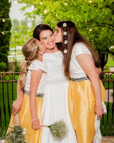 Sisters of the Bride Give Her a Kiss