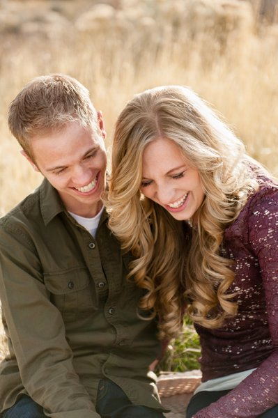Young Engaged Couple Share a Moment of Laughter