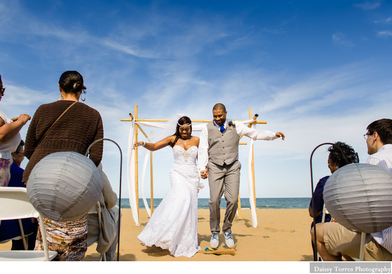 Bride and Groom jumping the Broom