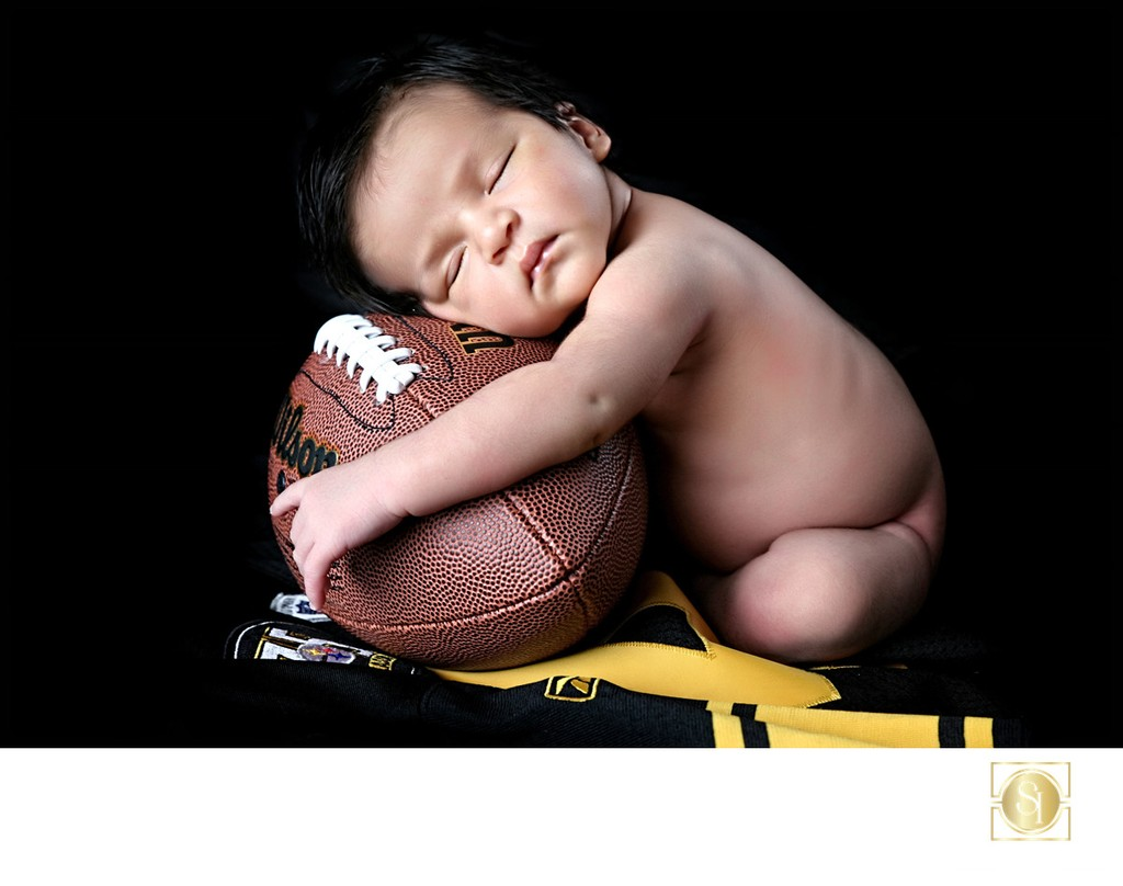 Newborn Photography Boy with Football Portrait