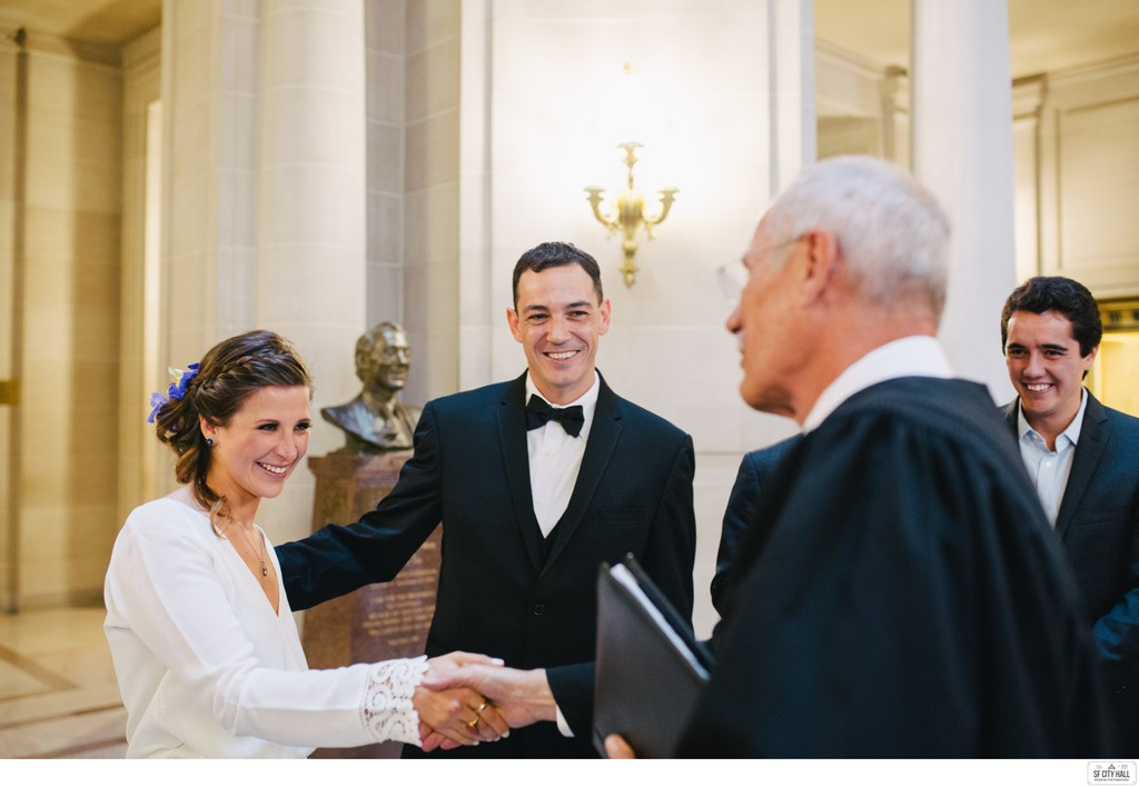 Couple and Wedding Officiant at SF City Hall