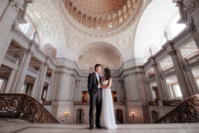 Couple on Top of Grand Staircase