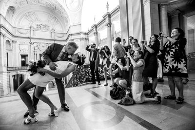 Passionate Kiss by the Grand Staircase