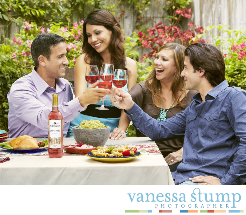 Lifestyle image of two couples enjoying wine.