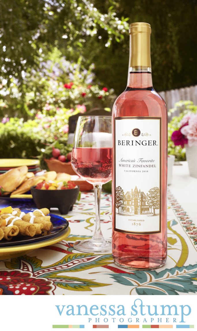 Environmental product photography for Beringer White Zinfandel in a back garden.