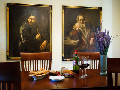 Happy Hour with two somber paintings