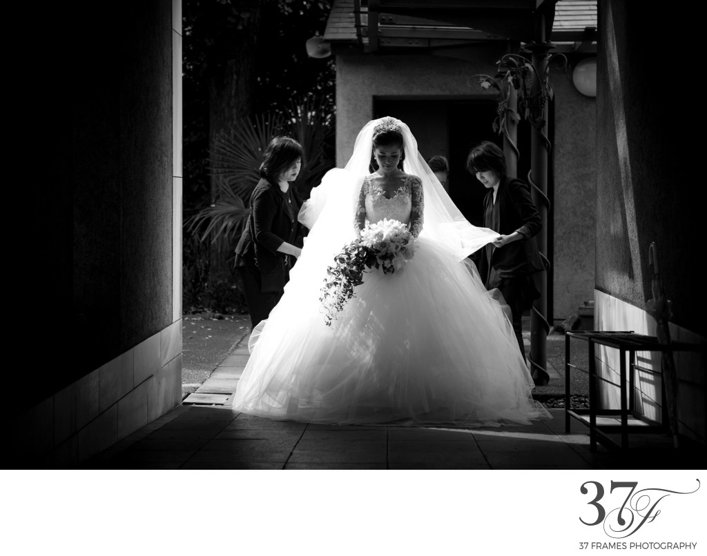 Backlit Bride getting ready to enter the Church | Tokyo