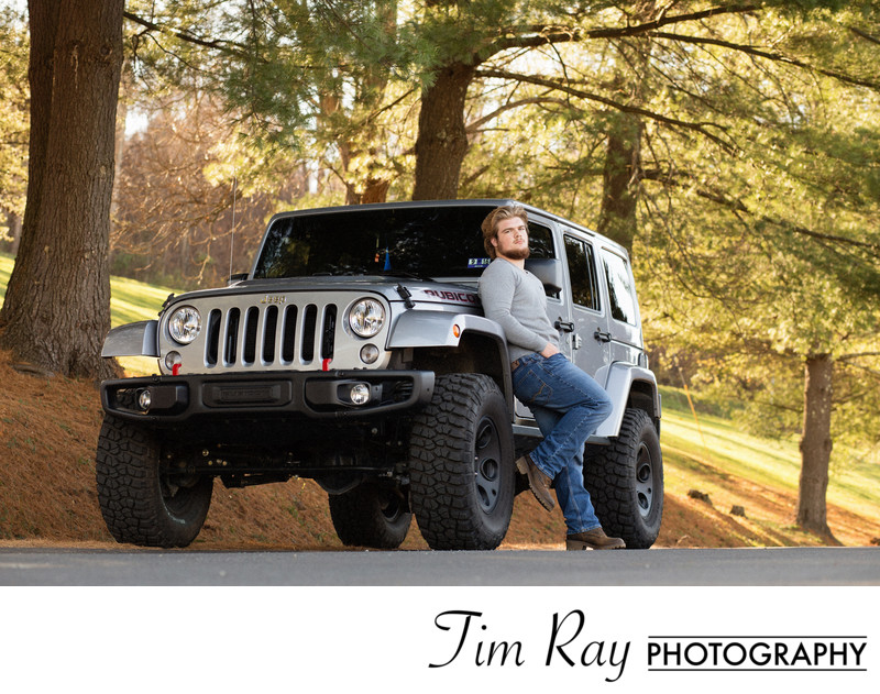 Senior Portrait of a boy with his Jeep
