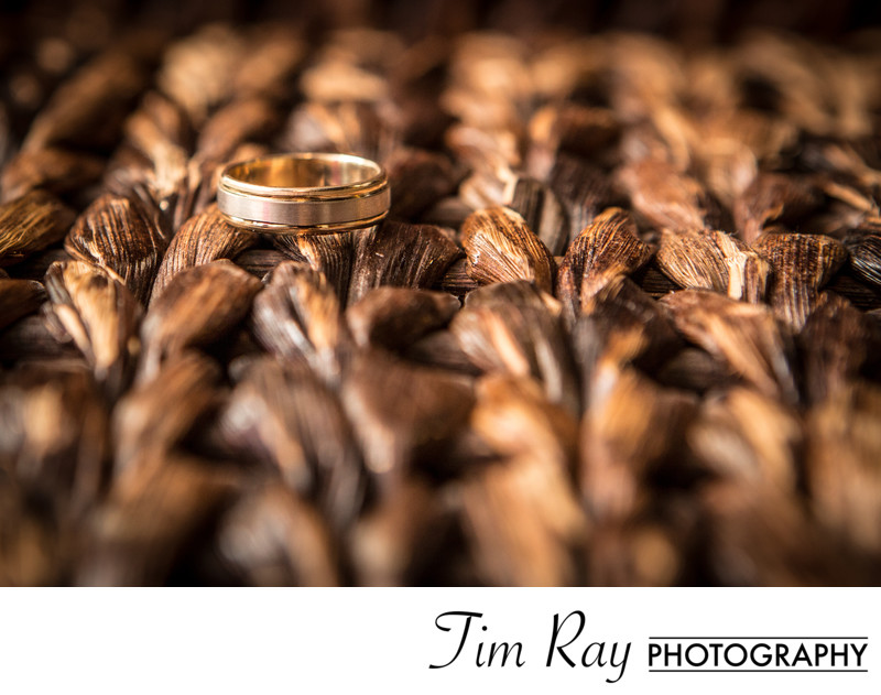 Grooms Ring on textured wicker table