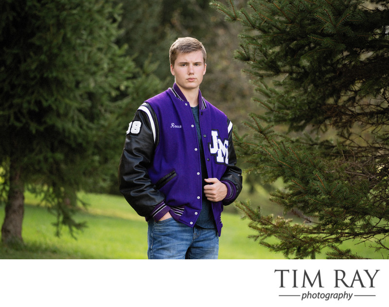 Senior boy in lettermen's jacket by wv senior portrait photographer Tim Ray
