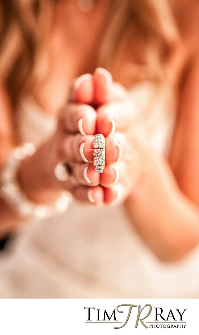 Unique photo of bride holding her wedding band.