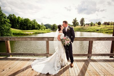 Wedding Couple on the walking bridge at Stone Wall Resort - West Virginia Wedding Photographs: Top Photographer - Tim Ray Photograph