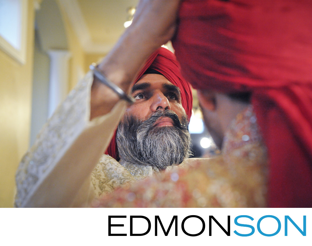 DFW Indian Sikh Weddings Father Places Turban On Son