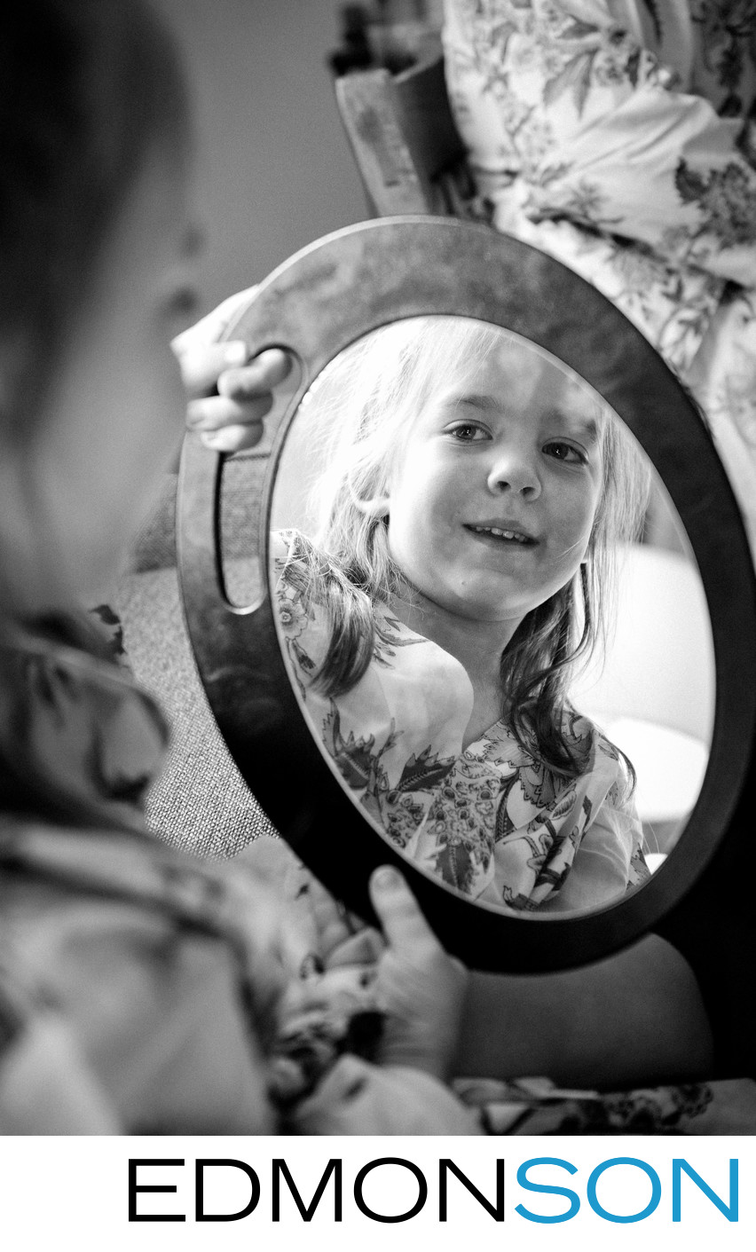 Cute Flower Girl Checks Herself Out In Mirror