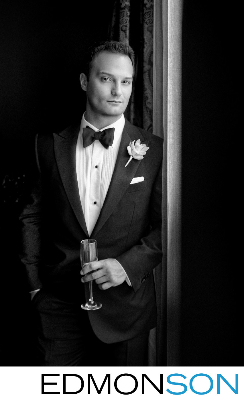 Black And White Groom Holds Glass In Portrait