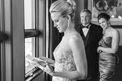 Bride Reads Sweet Card From Parents Rough Creek Wedding