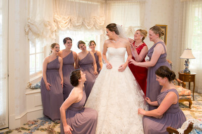 Loving Bridesmaids Fuss Over Brides Dress