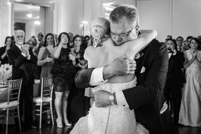 Father Holds Daughter At Brook Hollow Wedding Reception