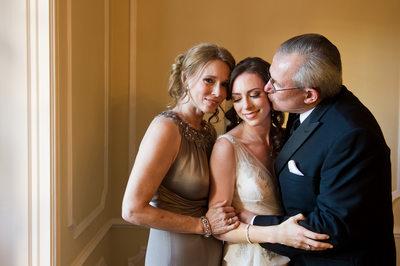Loving Parents Embraces Warwick Melrose Bride