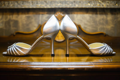 Park Cities Bride's Shoes On Table In Her Home