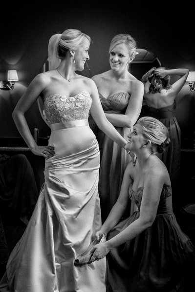 Bridesmaids Help Bride Finishing Touches On Wedding Day