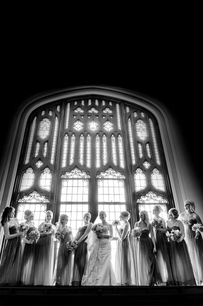 Huge Glass Window Creates Epic Bridal Party Photo