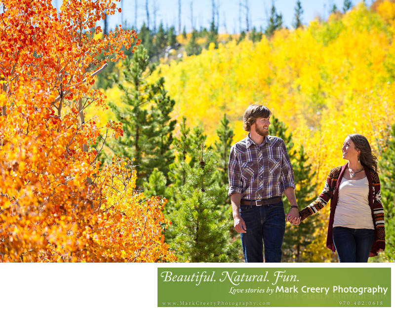 Outdoor engagement photos with bright Fall colors