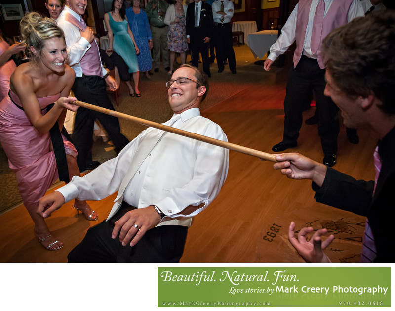 Groom doing the limbo at Colorado wedding