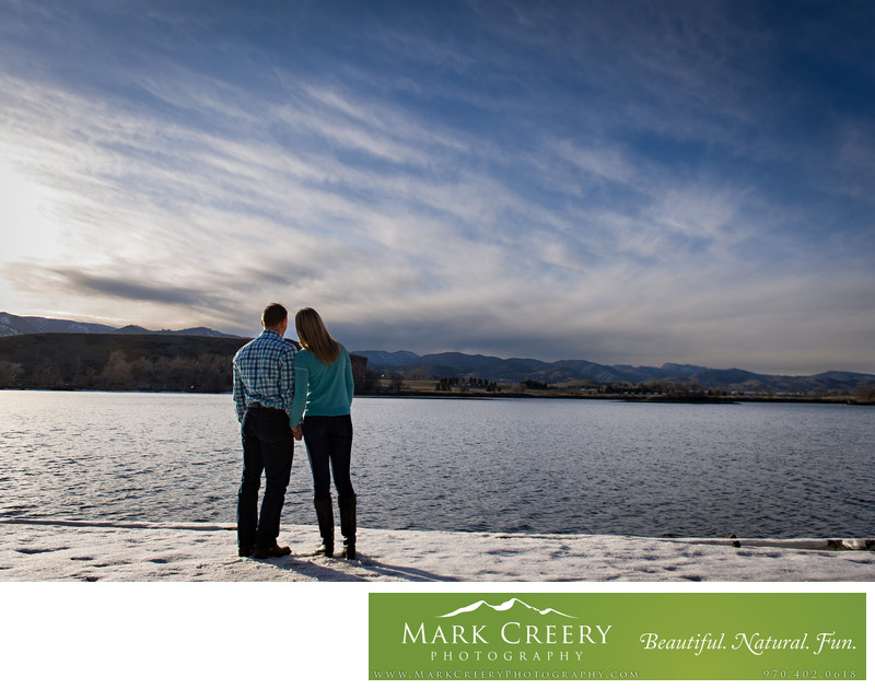 Couple watching winter sunset at Fort Collins engagement