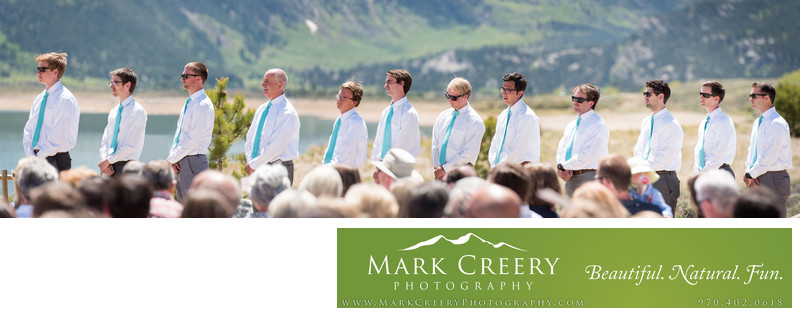 12 Groomsmen lined up during wedding ceremony in Colorado