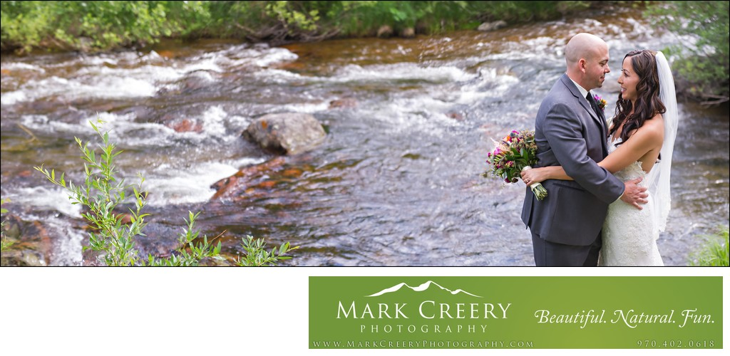Bride & Groom at North Saint Vrain Creek at Wild Basin Lodge