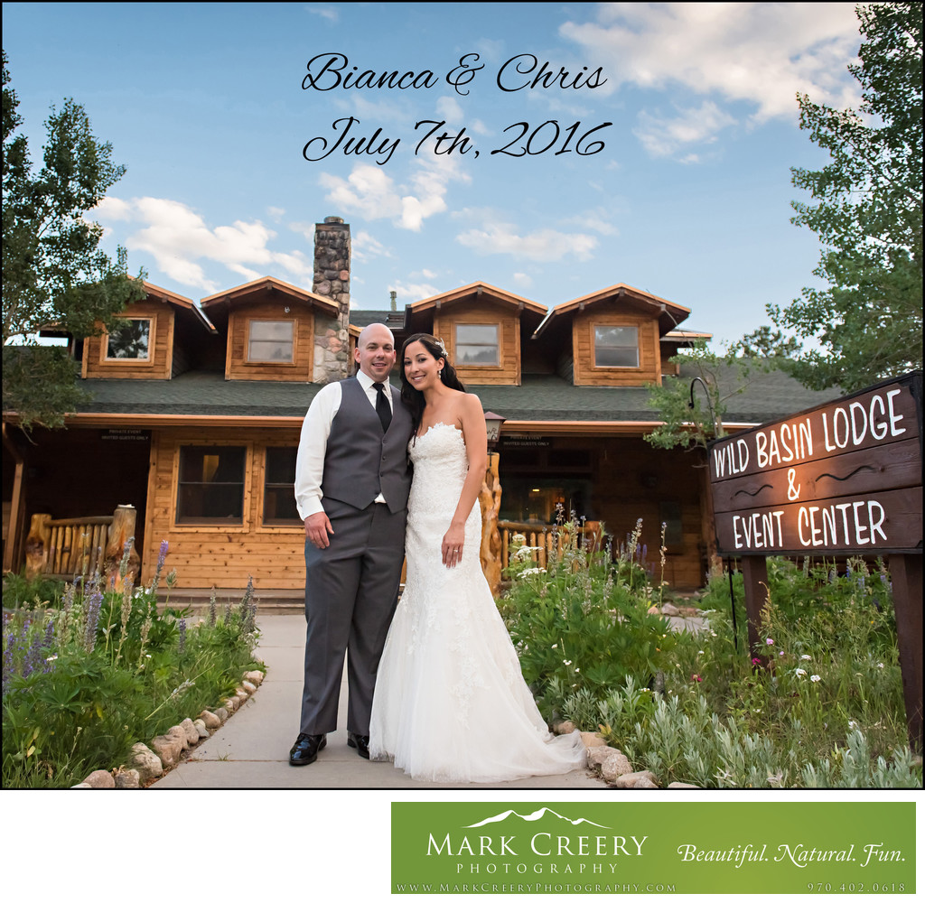 Bride & Groom standing in front of Wild Basin Lodge
