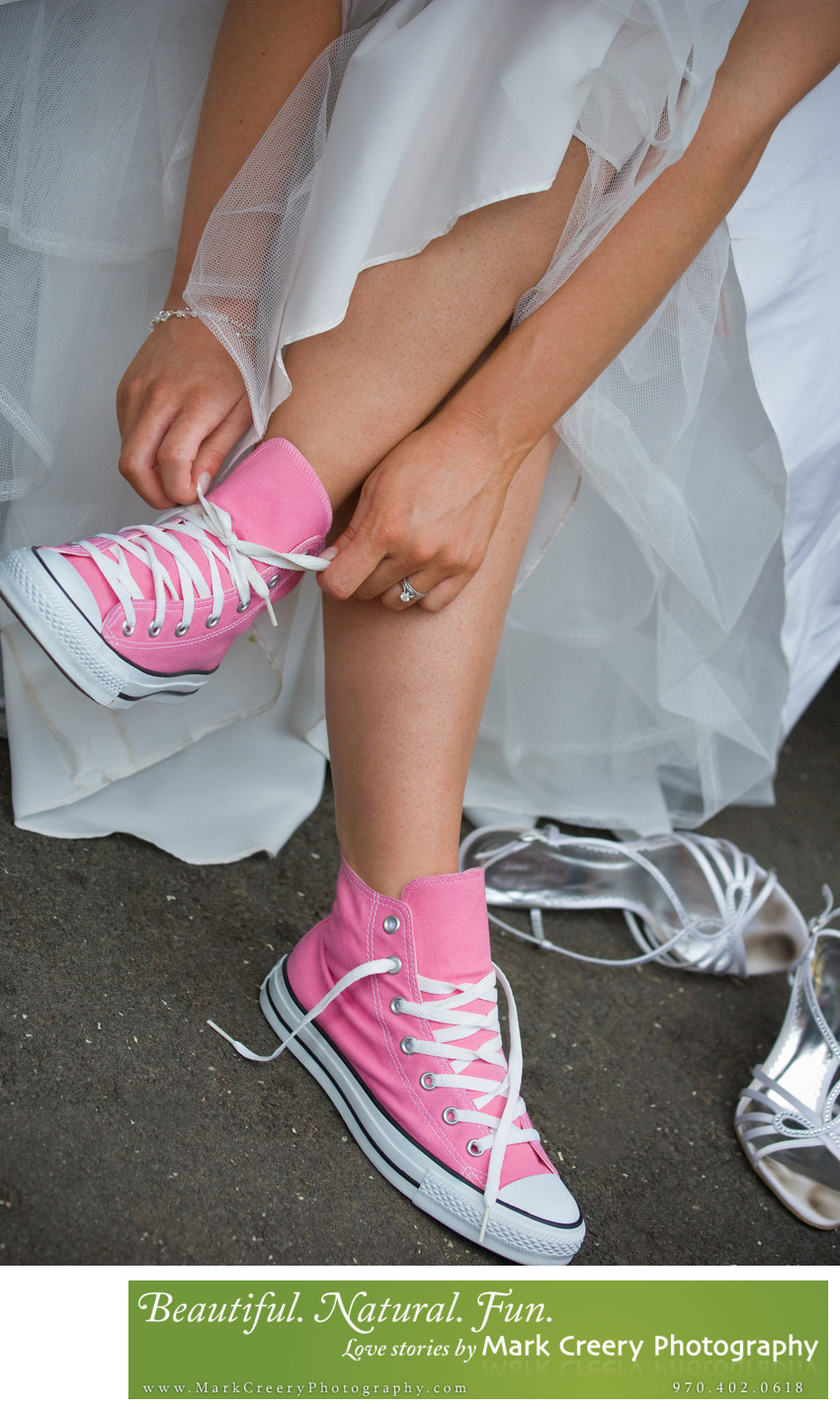 bride wearing pink converse shoes wedding photo