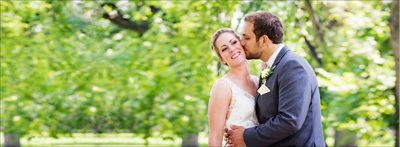 Bride & Groom kissing at Colorado State University Oval