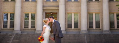 Couple kissing at Colorado State University Oval wedding