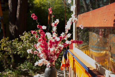 Flower and prayer wheel in the Nyingma Institute garden