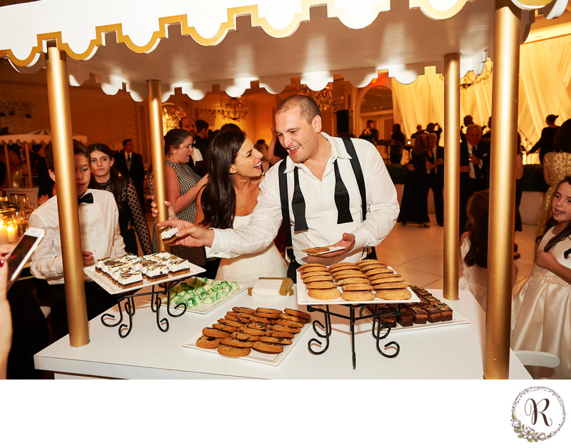 Bride & Groom Enjoying Dessert Stations