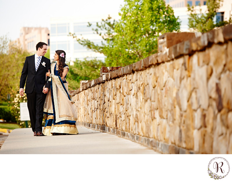 Bride and Groom Walking on the Bridge by Westin Dulles