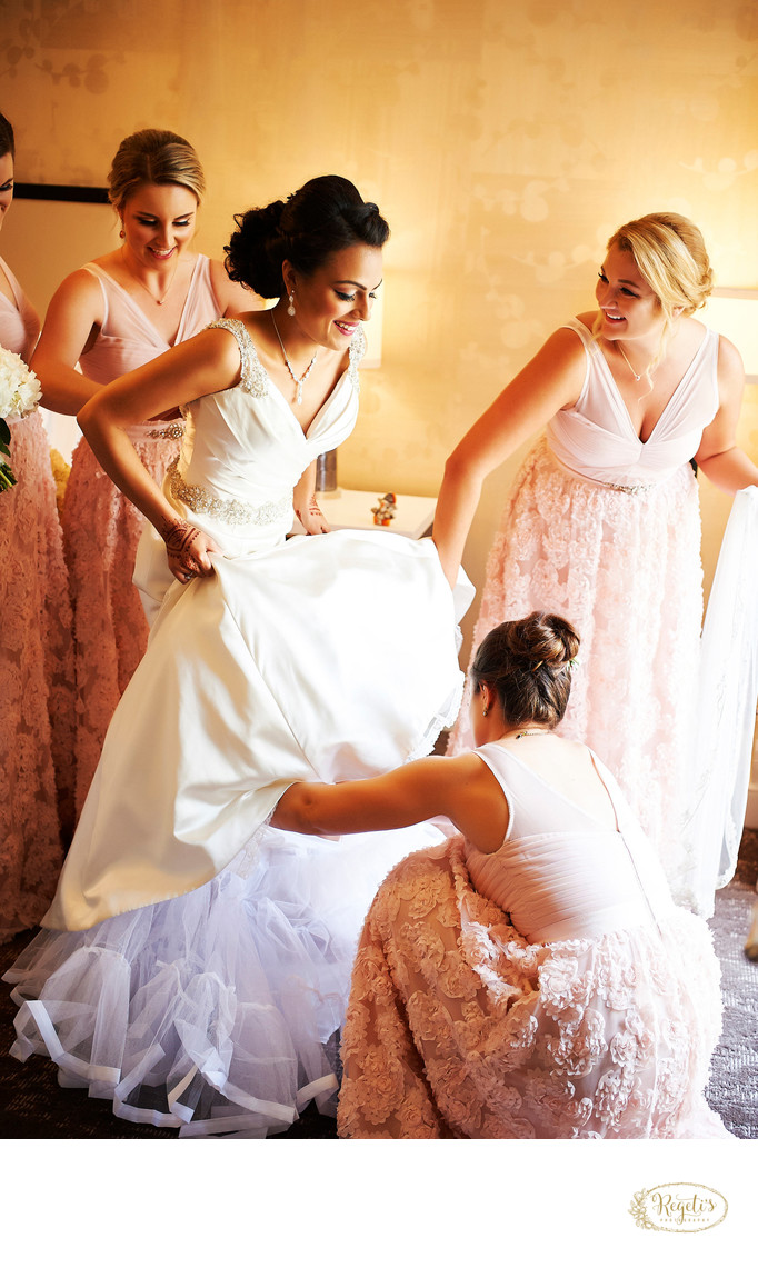Bridesmaids Helping the Bride to Get Ready