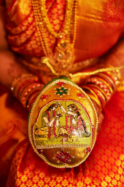 Telugu bride holding a decorated coconut